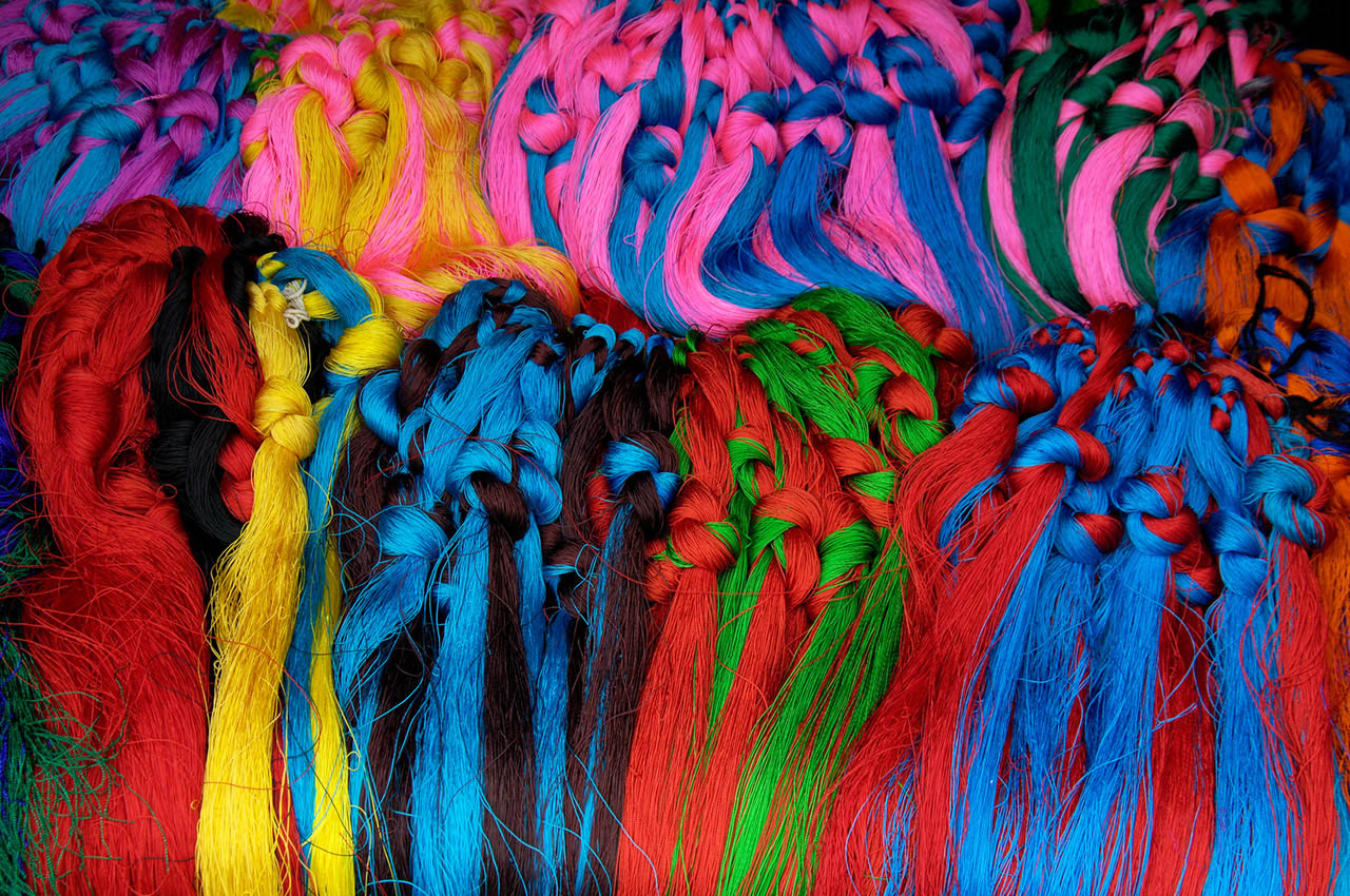 Colorful decorative strings for braiding into the hair by Tibetans, Tibet, ©2017